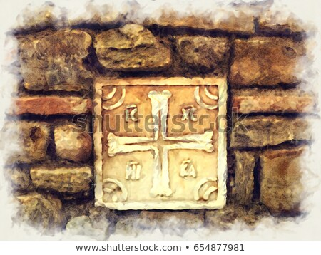 ancient greek cross made of marble on the stone wall stock photo © ankarb