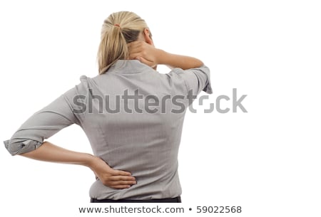 Woman massaging pain back isolated over a white background Stock photo © Nobilior