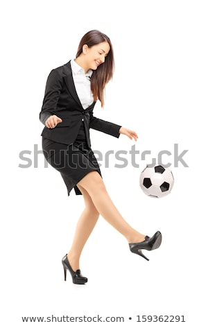 Young businesswoman kicking on white background studio Stock photo © ambro
