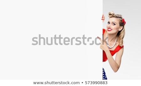 glimlachend · pinup · meisje · poseren · gelukkig · jonge - stockfoto © NeonShot