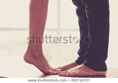 mujer · piernas · jeans · descalzo · aislado - foto stock © GeniusKp