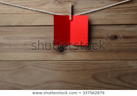 Red Greetings Card Pegged to String on Wood Planking Stock photo © frannyanne