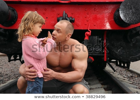 strong shirtless man sits on railroad with little girl stock photo © paha_l