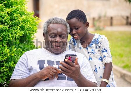 Smiling african old man Stock photo © zurijeta
