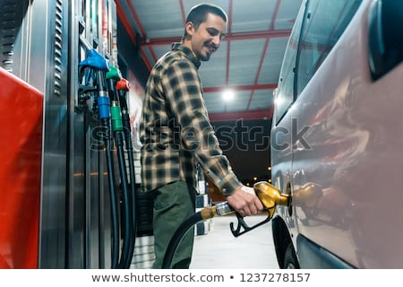 homem · Óleo · lata · enchimento · bocal · em · pé - foto stock © rastudio