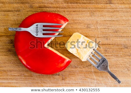Creative arrangement of wax covered cheese wheel Stock photo © ozgur