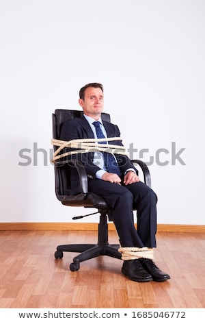 Businessman bound with rope Stock photo © cherezoff