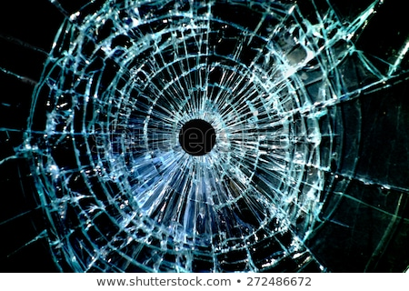 Bullet hole and pieces of shattered or smashed glass Stock photo © Arsgera