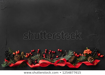 Red and green themed Christmas wreath on wood Stock photo © ozgur