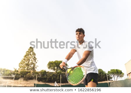 moço · raquete · de · tênis · isolado · preto · sorrir · homem - foto stock © dotshock