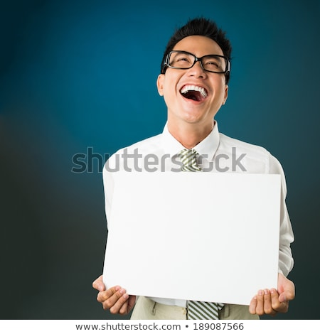 young asian businessman laughing out loud stock photo © rastudio