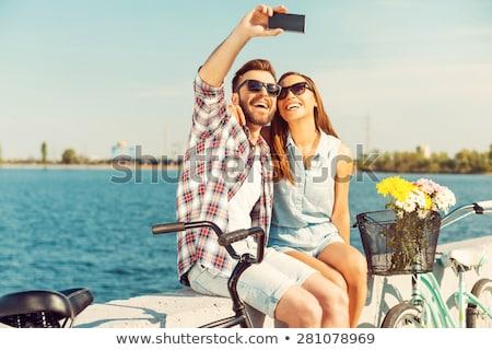 Making selfie of couple Stock photo © deandrobot