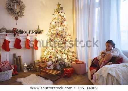 Girl sitting near boxes Stock photo © deandrobot