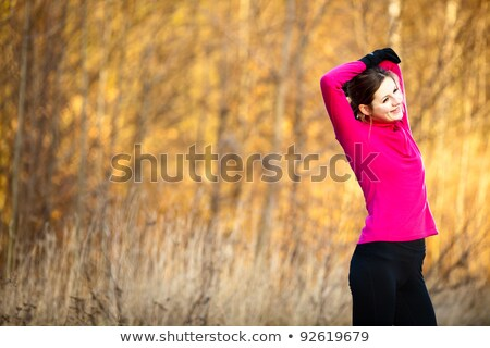 young woman stretching before her run outdoors stock photo © chesterf