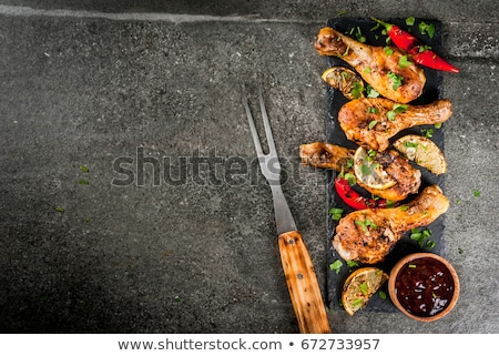 Grilled Chicken Legs And Wings With Barbecue Sauce Stock photo © mpessaris