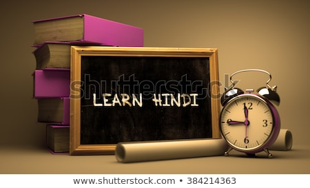 Hand Drawn Learn Hindi Concept on Chalkboard. Stock photo © tashatuvango