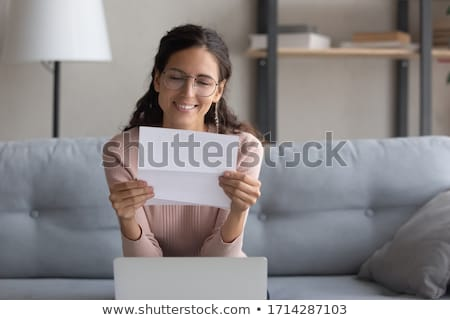 Young woman reading a letter stock photo © IS2