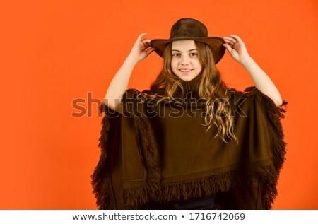 Pretty girl wearing western hat. Stock photo © rcarner