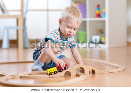 A boy playing with his toys Stock photo © IS2