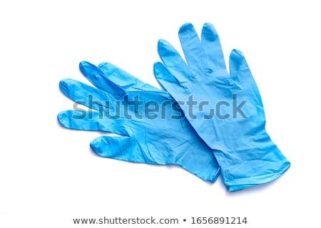 Genç kadın mavi lastik eldiven mutfak ev seksi Stok fotoğraf © Nobilior