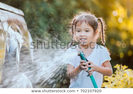 young girl washing car Stock photo © IS2