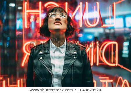 Image of good looking woman in light clothes standing  Stock photo © Traimak