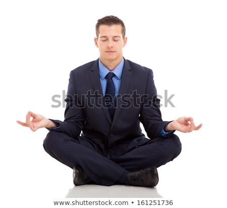 Caucasian white man meditating in lotus pose. Stock photo © RAStudio
