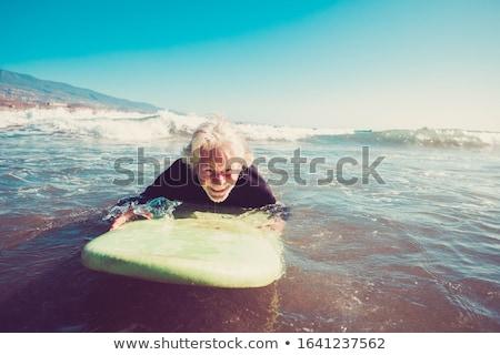 Férfi szörfdeszka víz égbolt jókedv szabadság Stock fotó © IS2