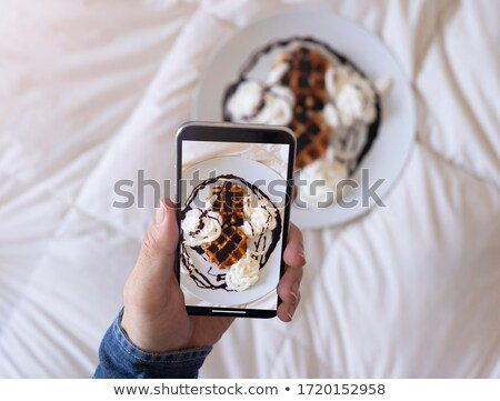 Close up of man's hand taking photograph Stock photo © IS2