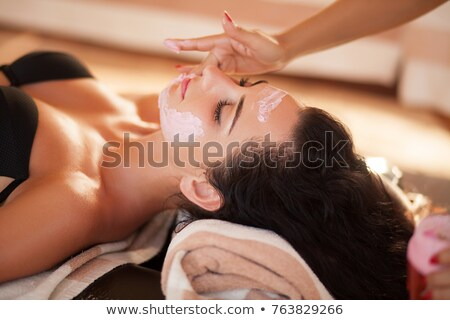 Close-up of the face of a woman relaxing in a modern beauty center Stock photo © Kzenon
