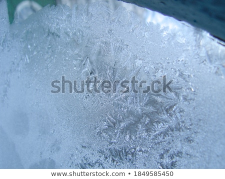 Pattern of pieces of clear glass ice on a blue background Stock photo © artjazz