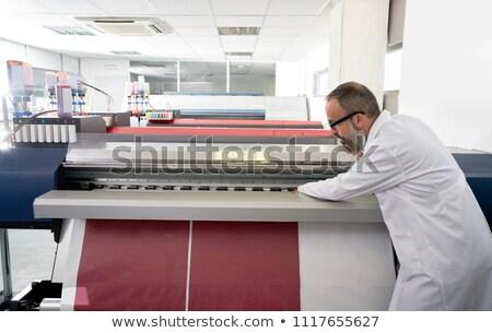 Stock photo: Espertise man in transfer printing industry plotter