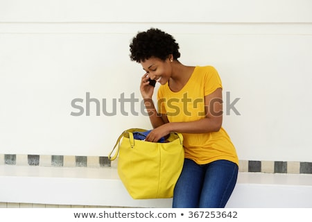 Woman Looking Inside Handbag Stock photo © AndreyPopov