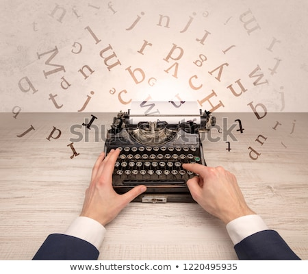 First person perspective elegant hand typing with flying letters concept Stock photo © ra2studio