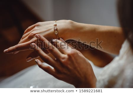 Elegant bridal hand with silver bracelet. Morning bridal preparation with stylish accessories. Stock photo © ruslanshramko