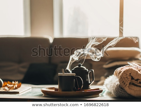 Woman with steaming hot tea Stock photo © grafvision