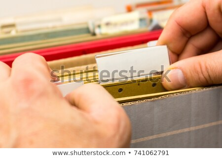 Stock photo: File folders with a tab labeled Health Insurance