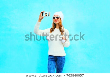 smiling young woman taking selfie with cell phone in winter out stock photo © boggy