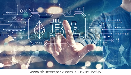 businessman with at cryptocurrency icons Stock photo © dolgachov