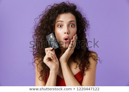 портрет красивая женщина темно вьющиеся волосы красное платье Сток-фото © deandrobot