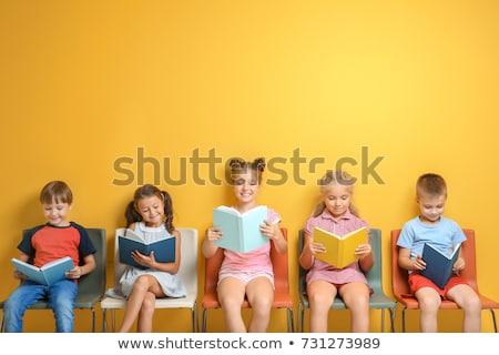boy and girl reading books stock photo © colematt