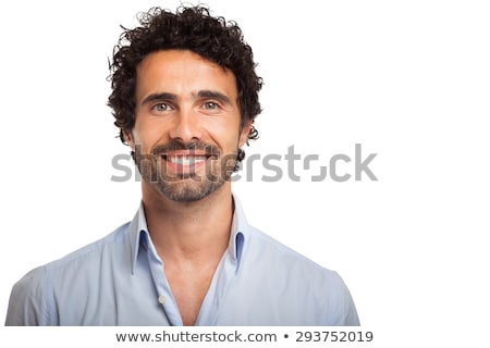 portrait of a smiling young man with curly hair stock photo © deandrobot
