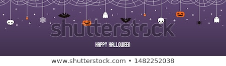 carved pumpkins with candies and halloween garland Stock photo © dolgachov