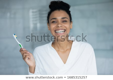 tooth and toothbrush in the room stock photo © make