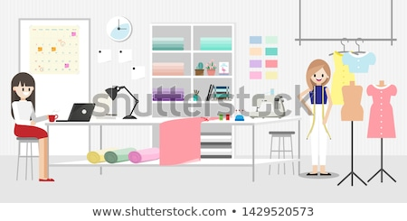 fashion designer with coffee and book at studio Stock photo © dolgachov
