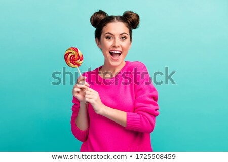 portrait of woman sucking her candy stock photo © vankad