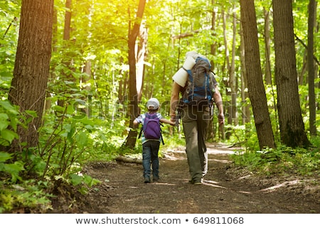 Family in hiking. Dad and son walking in the forest with trekkin Stock photo © galitskaya