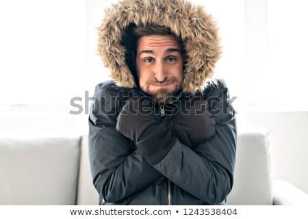 Férfi influenza kanapé otthon tél kabát Stock fotó © Lopolo
