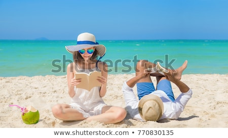 Young, attractive couple resting on a tropical beach Stock photo © majdansky