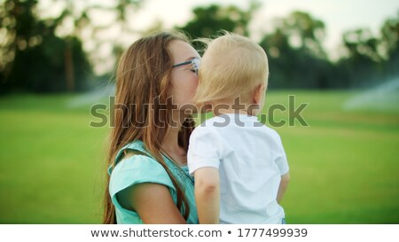 lifestyle portrait of cute caucasian girls sisters holding littl stock photo © dashapetrenko